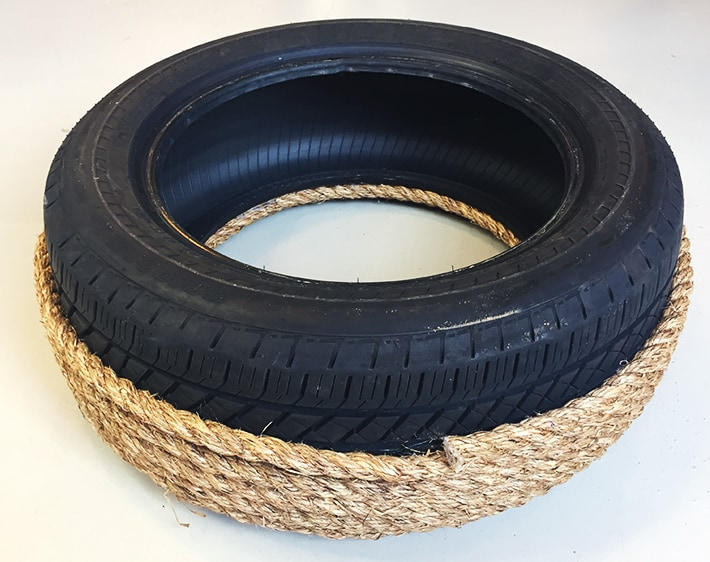 Step 2 - DIY Ottoman - Rope glued around base of tire for support
