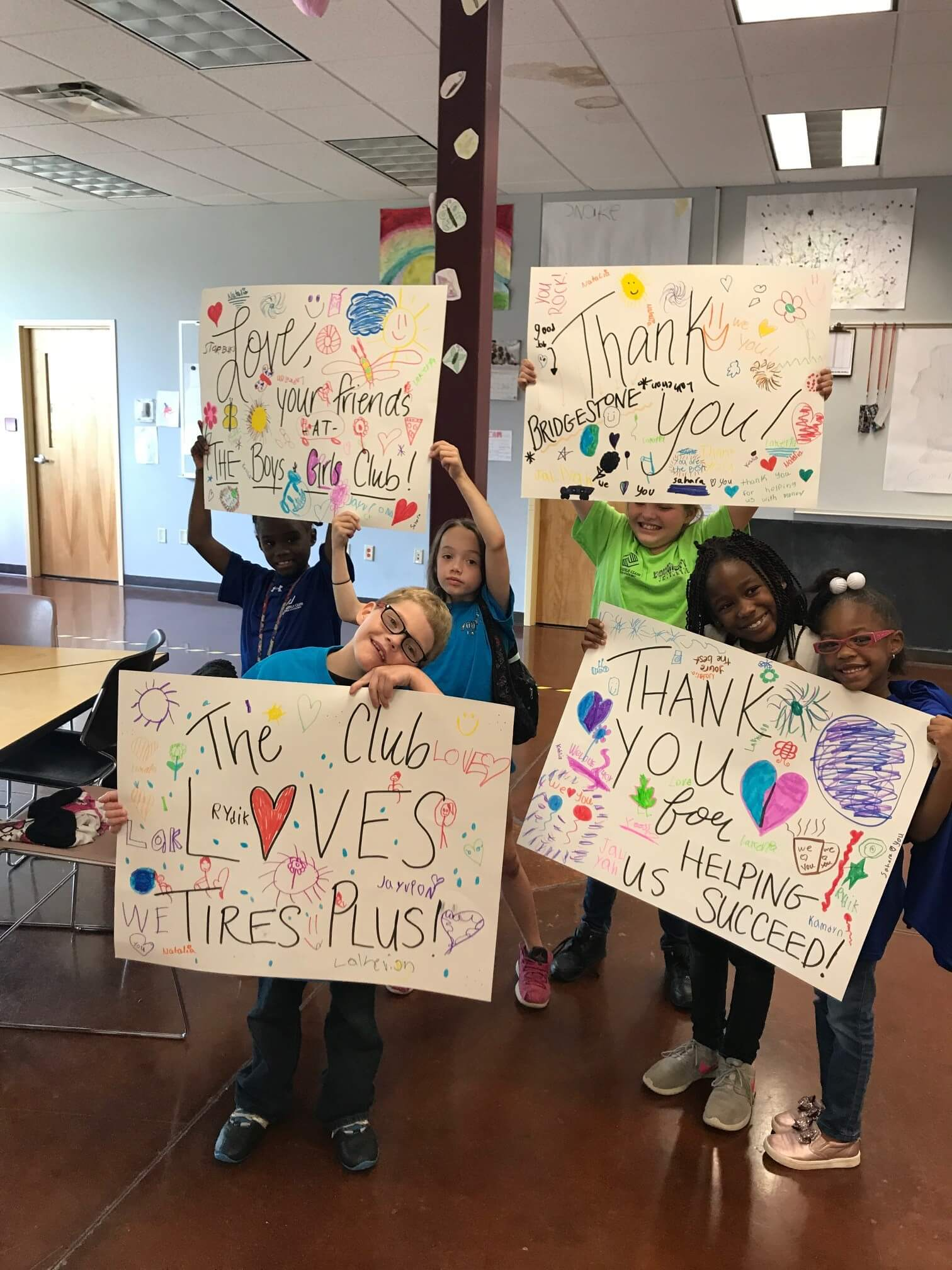 BGC of Green Bay Members Showcase Thank You Signs for Tires Plus