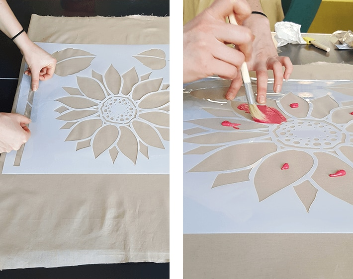 Using stencil to paint holiday design on floor mat fabric