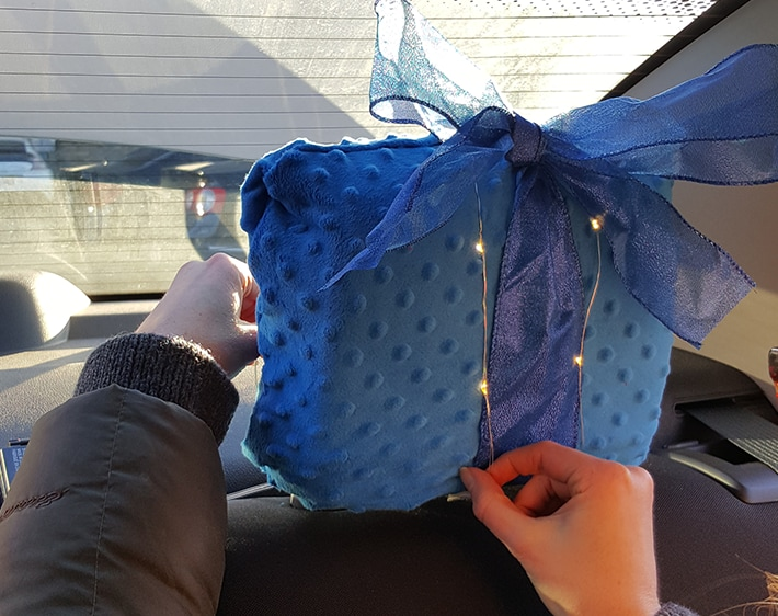 Tying ribbon around festive headrest cover