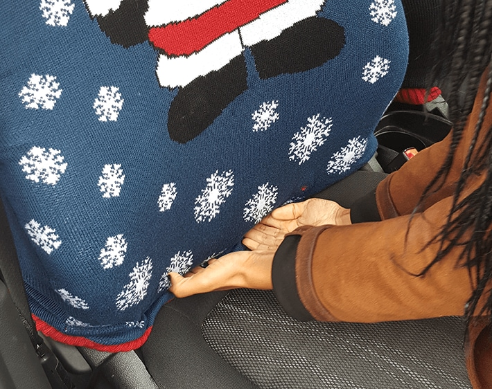 Tuck sweater into the seat cushion