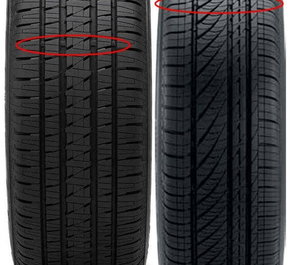 Tread wear bar on new tire circled in red