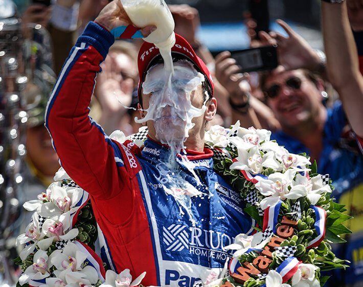 Indy 500 winner pouring milk on his face