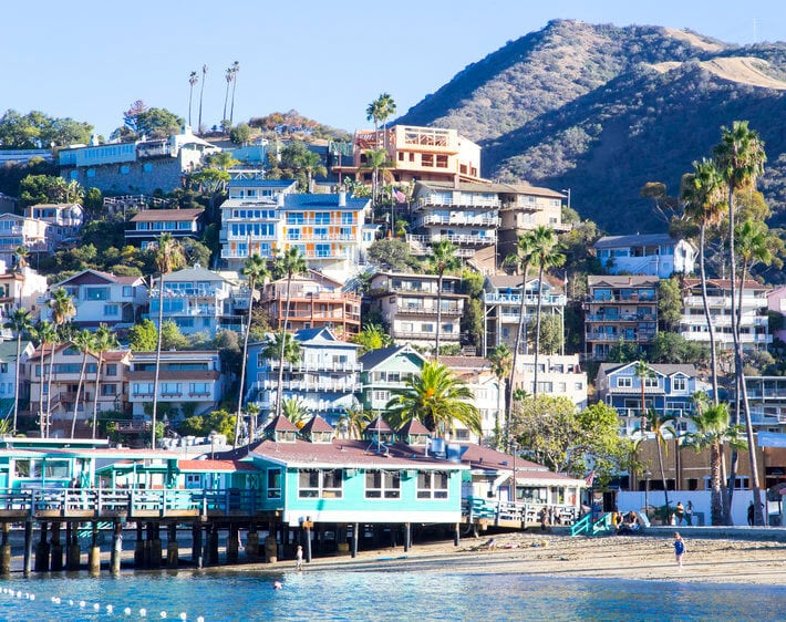 southern california beachfront vista with multi-colored houses and mountain