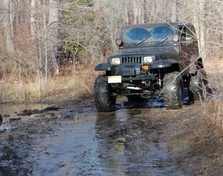 4wd truck offroading in mud