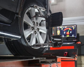 Close up view of tire and wheel during wheel alignment