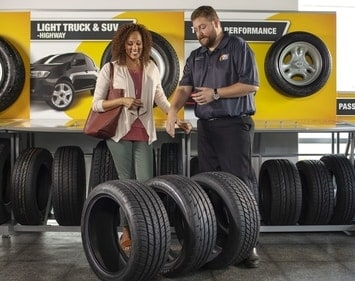 woman shopping for tires with help from tires plus teammate