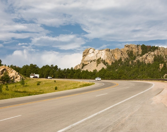 Open highway with cliff in the background