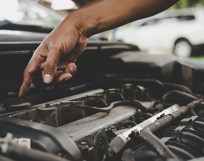 Man pointing to engine