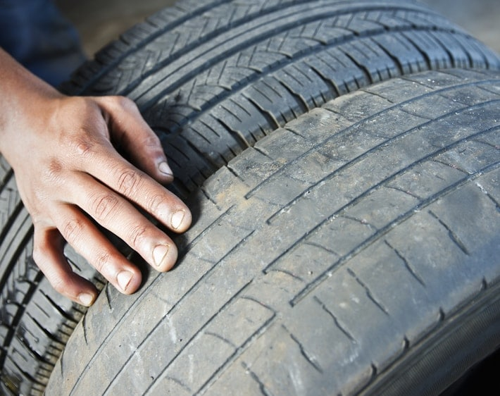 Person feeling a worn down tire