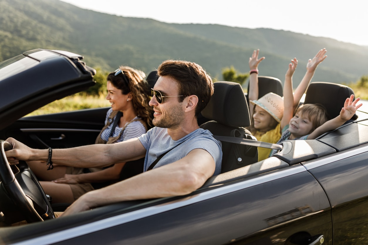 image of a family having fun on a road trip
